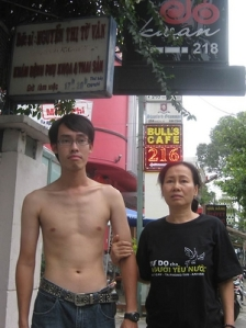 Police detained Nguyen Tri Dung and his mother to prevent them from attending the trial of three prominent bloggers, including his father Nguyen Van Hai on September 24, 2012. After the court sentenced the bloggers, police stripped Dung's t-shirt which featured the slogan: Freedom for Patriots. © 2012 VRNs